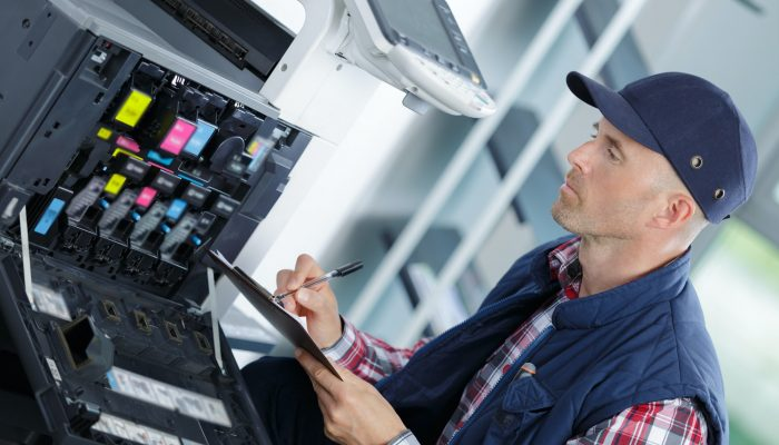 handyman fixing the office printer